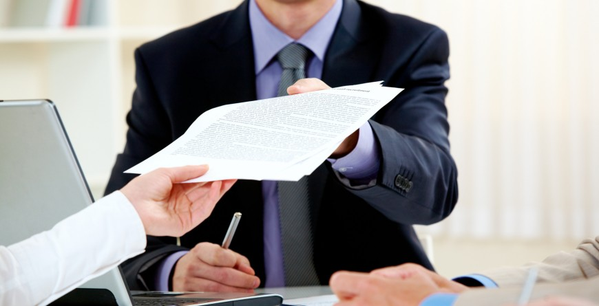 Close-up of handing over documents during business briefing